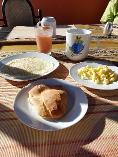 Smoothie juice, black coffee, crepe, scrambled eggs, and a hearty piece of bread--wow!